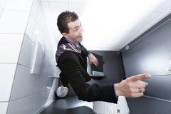 Idee auf dem Toilettensitz Stockbilder