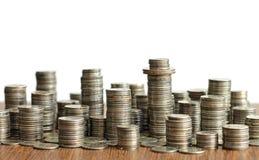 Idee des Materialismus - Stadt gemacht von den Münzen Stockfoto