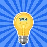 Ideenkonzept mit Glühlampe mit blauen Strahlen Stockbild