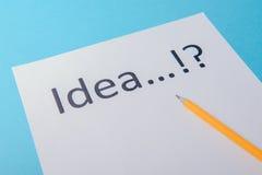 Ideenwort auf Weißbuch Lizenzfreie Stockbilder