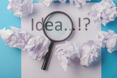 Ideenwort geschrieben auf Papier Lizenzfreie Stockfotografie