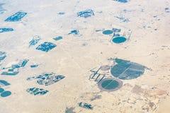 Ideia aérea de campos circulares no deserto Imagem de Stock