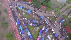 Ideia da antena/zangão do mercado semanal do mantimento de Indonésia vídeos de arquivo