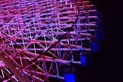 Ideia da noite da iluminação do ` s da roda de Ferris fotografia de stock