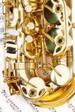 Ideia da peça brilhante da curva do saxofone do alto com chaves imagem de stock royalty free