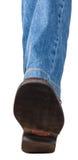 Ideia direta do pé esquerdo nas calças de brim e na sapata marrom Fotografia de Stock