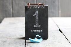 A ideia do campeão ou do líder, numera um primeiro vencedor do lugar Imagens de Stock