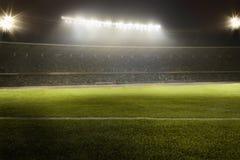 Ideia do campo de futebol na noite Fotos de Stock Royalty Free