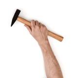 Ideia do close-up de um man& x27; mão de s que guarda o martelo, isolado no fundo branco Foto de Stock Royalty Free
