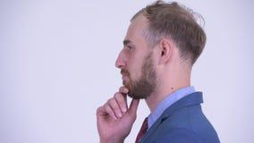 Ideia do perfil do pensamento farpado feliz do homem de negócios vídeos de arquivo