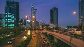 ideia do Tempo-lapso do tráfego na cidade de Ho Chi Minh do por do sol ao nivelamento filme