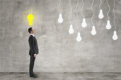 Ideia, homem de negócios e bulbo Fotografia de Stock Royalty Free