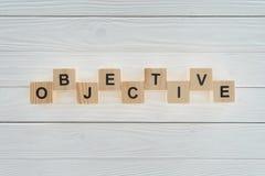 ideia superior da palavra objetiva feita dos blocos no branco imagem de stock