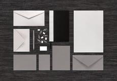 Ideia superior de artigos de papelaria vazios e do moc de marcagem com ferro quente da identidade corporativa Imagens de Stock