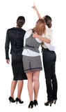 Ideia traseira de apontar da mulher de negócio de três jovens. imagem de stock royalty free