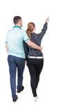 Ideia traseira de apontar novo de passeio dos pares (homem e mulher) imagens de stock