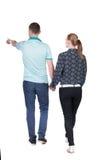 Ideia traseira de apontar novo de passeio dos pares (homem e mulher) fotografia de stock