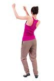 Ideia traseira de dançar a mulher bonita nova observação da menina Imagens de Stock