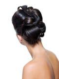 Ideia traseira de um penteado curly à moda Fotografia de Stock