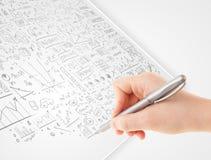 Ideias de esboço da mão humana em um Livro Branco Fotografia de Stock Royalty Free