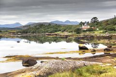 House by the sea in Connemara, Ireland. Idellic picturesque house my the sea in the Connemara region of Galway, Ireland Stock Photos