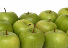 Identical concepts with apples. Identical concepts - croud of many green apples Royalty Free Stock Photography
