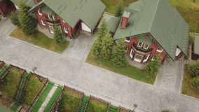 Identical houses with a green roof. Aerial view stock footage