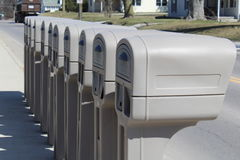 Identical mailboxes in a row Stock Photo
