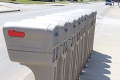 Identical mailboxes in a row Royalty Free Stock Photo
