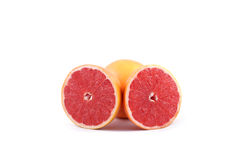 Identical parts of a grapefruit Royalty Free Stock Photo