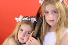 Identical twin flower girls. Shot of identical twin flower girls Royalty Free Stock Images