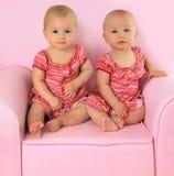 Identical twin girls Stock Photo