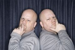 Identical twin men. Royalty Free Stock Images