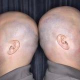Identical twin men. stock image