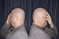 Identical twin men. Royalty Free Stock Photos