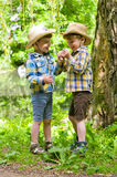 Identical twins in cowboy hats. Three year old identical twins play in the park. Children dressed in the colours of the Ukrainian flag. On the hat of one of the Stock Photos