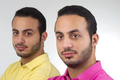 Identical Twins portrait shot against white background Stock Photo