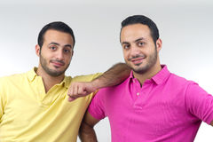 Identical twins portraits shot isolated Stock Photos