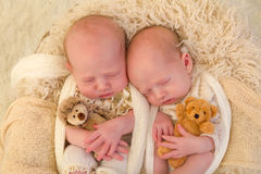 Identical twins with toys Royalty Free Stock Photo