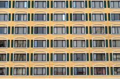 Identical windows in a large building Royalty Free Stock Image