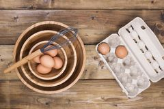 Identical wooden plates of different sizes, corolla for cooking and eggs, on a wooden background. Natural materials at home and in. The kitchen royalty free stock image