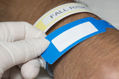 Identification Bracelet. Nurse checks hospital patient identification bracelet Stock Images