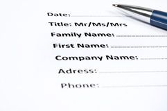 Identification form. And a pen stock photography