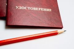 Identification of red crusts lie on a table with a pencil of red color. Inscription in Russian Identification of red crusts lie on a table with a pencil of red Royalty Free Stock Image