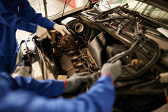 Identifying problem. Professional mechanic trying to identify problem with car Royalty Free Stock Photography