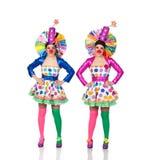 Identisk kvinnlig clown två arkivbilder