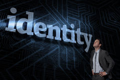 Identity against futuristic black and blue background Stock Photo