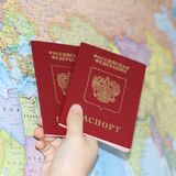 Identity document on the background of a geographical map. Passport of a citizen of the Russian Federation on the background of the card, which is written in stock image