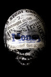 Identity fraud concept. Mask on black background with newspaper headlines about theft Royalty Free Stock Image