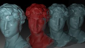 Identity. A series of sculptured faces, one of them in different color Stock Photo